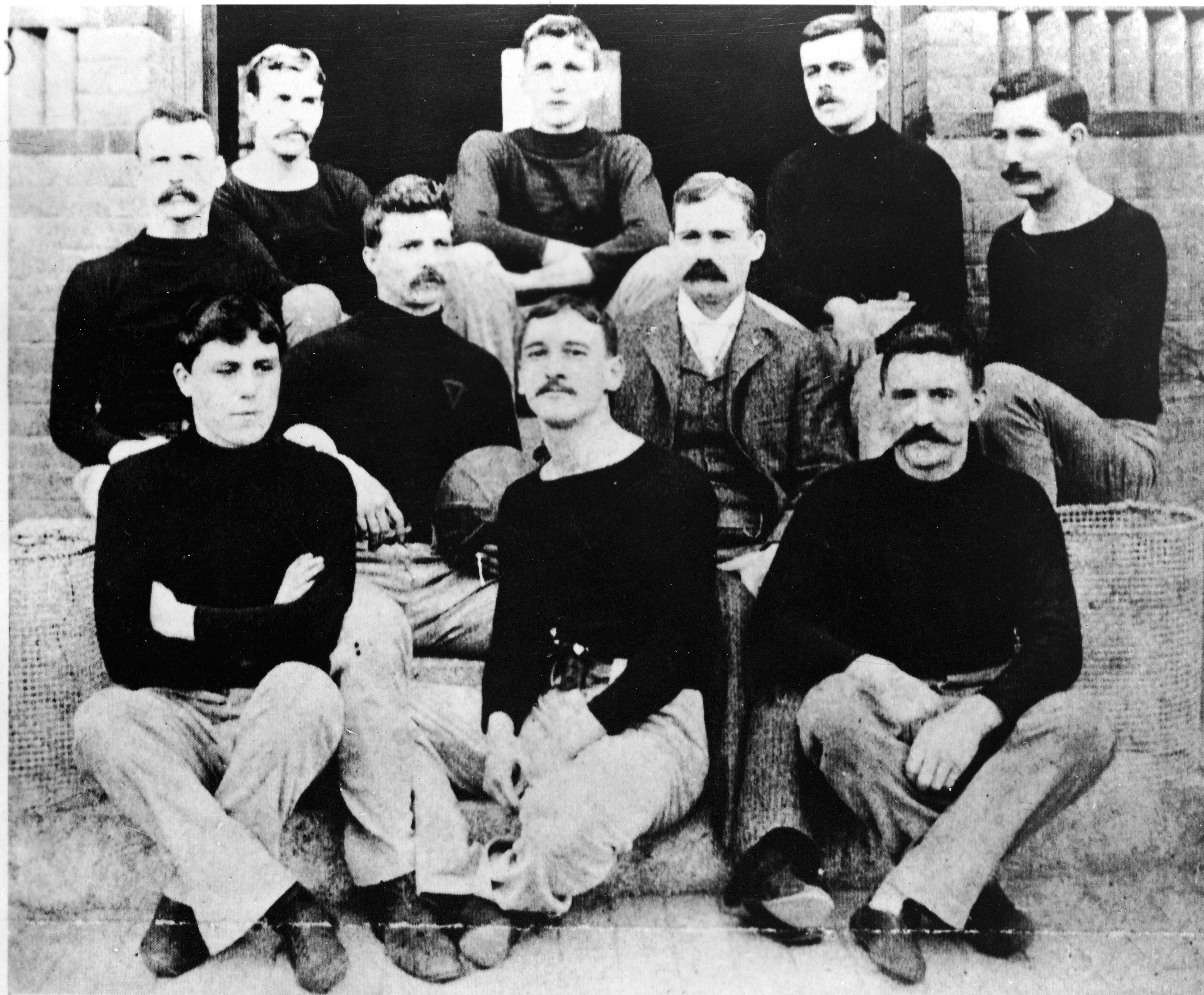 Dr. James Naismith (1861 - 1939) with his first basketball team in Springfield, Massachusetts, 1891.