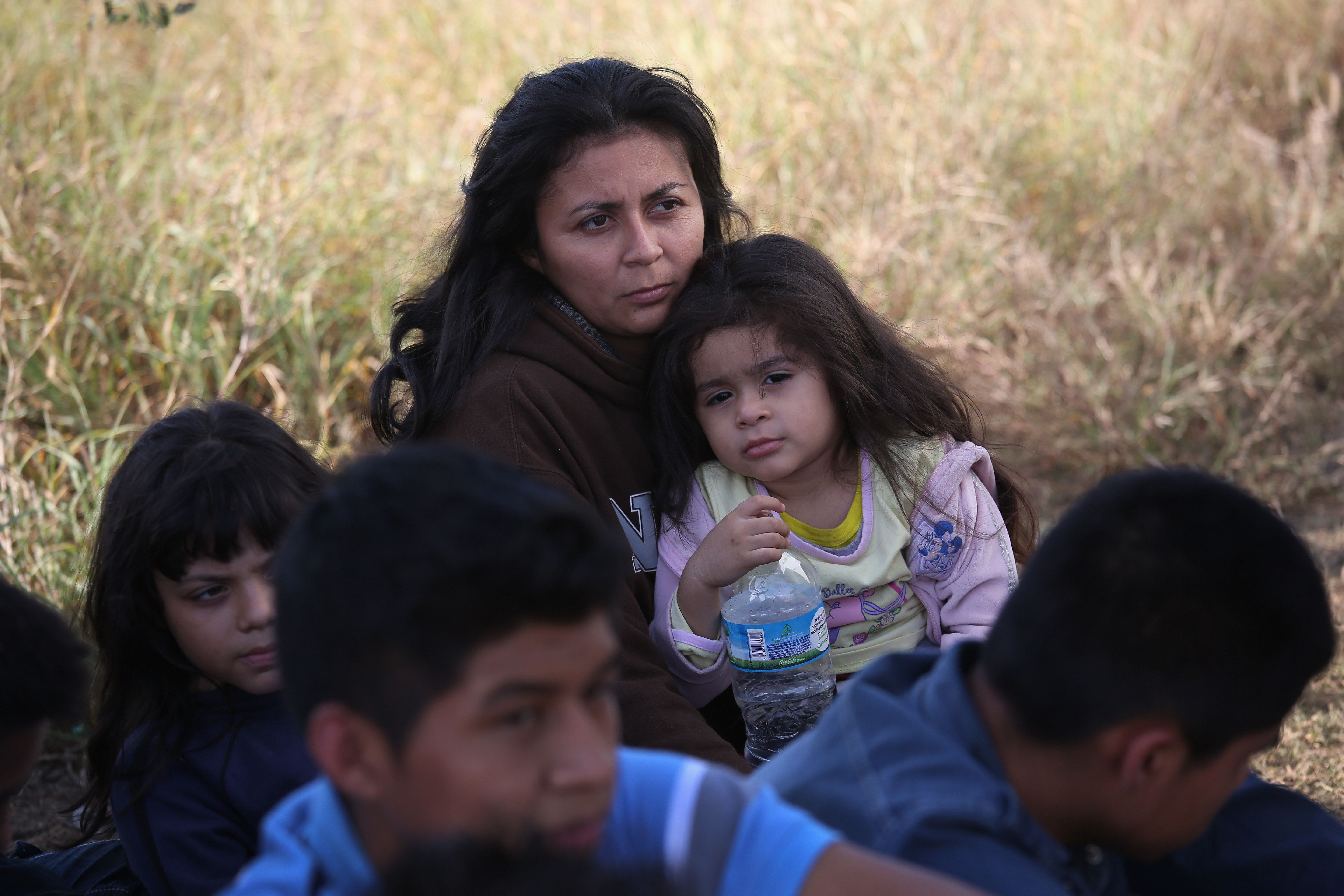 A Honduran mother holds her daughter, 3, after she turned her family in to U.S. Border Patrol agents on December 8, 2015 near