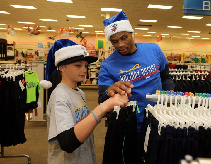 Westbrook doing other service work for the Oklahoma community earlier this week.In this picture, he'sassisting&nb