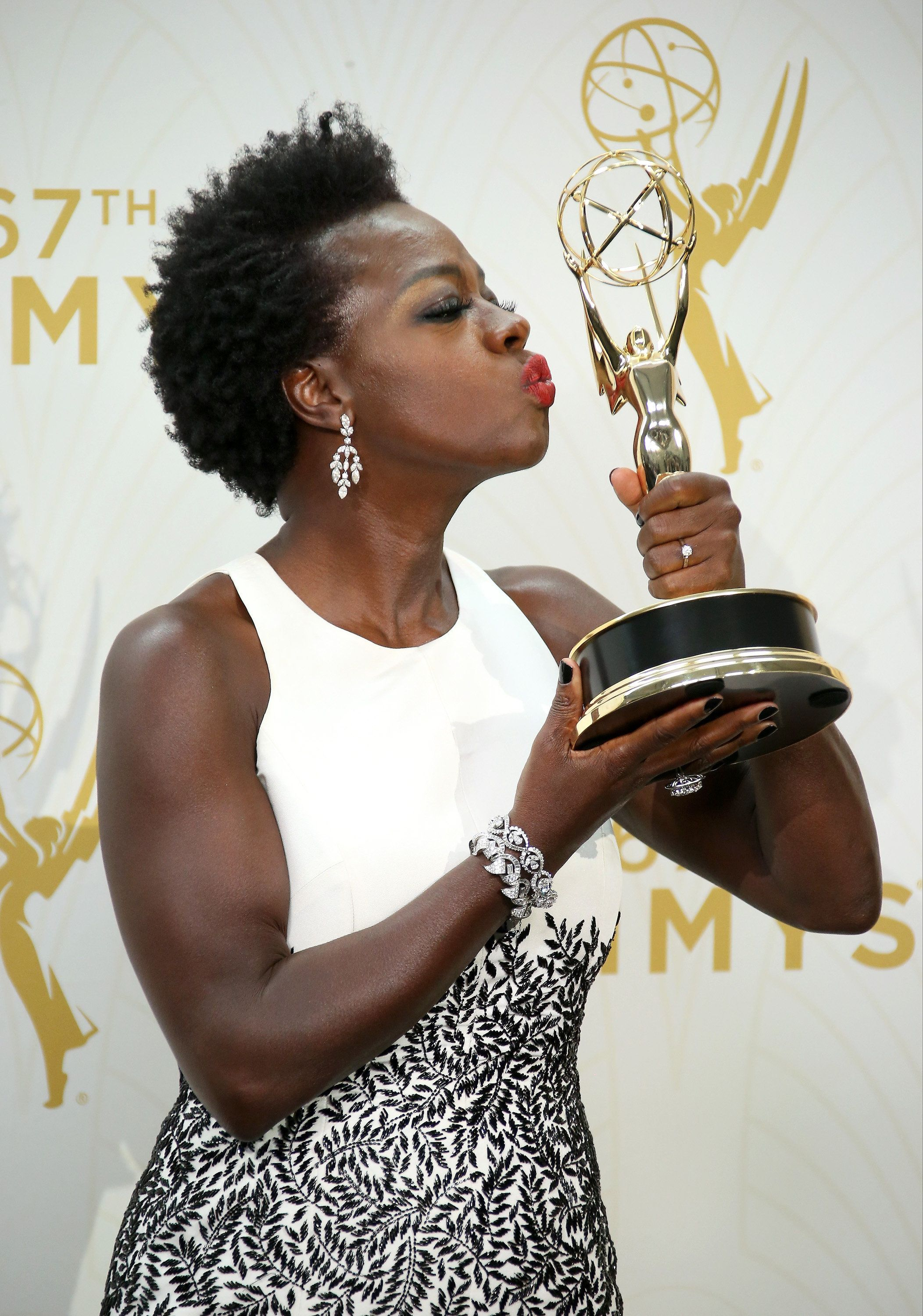 LOS ANGELES, CA - SEPTEMBER 20: Viola Davis poses with her award for Outstanding Lead Actress In A Drama Series in the photo room at the 67th Annual Primetime Emmy Awards at the Microsoft Theater on September 20, 2015 in Los Angeles, California. (Photo by Dan MacMedan/WireImage)
