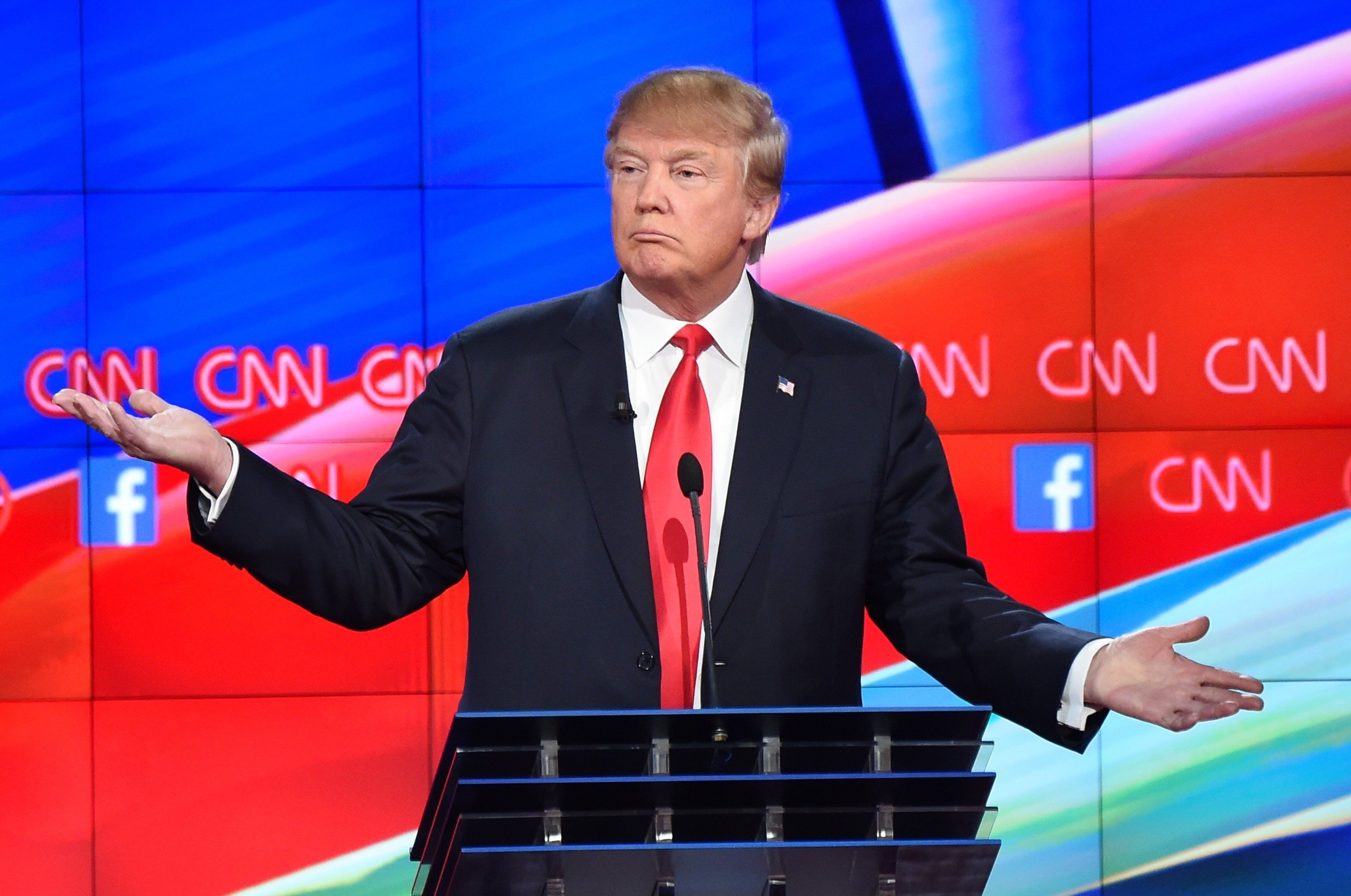 Republican presidential candidate businessman Donald Trump gestures during the Republican Presidential Debate, hosted by CNN, at The Venetian Las Vegas on December 15, 2015 in Las Vegas, Nevada.  AFP PHOTO/ ROBYN BECK / AFP / ROBYN BECK        (Photo credit should read ROBYN BECK/AFP/Getty Images)