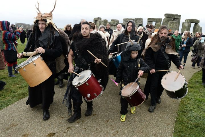Revelers take part in celebrations to mark the winter solstice at Stonehenge on December 22, 2014 in Amesbury, England. About