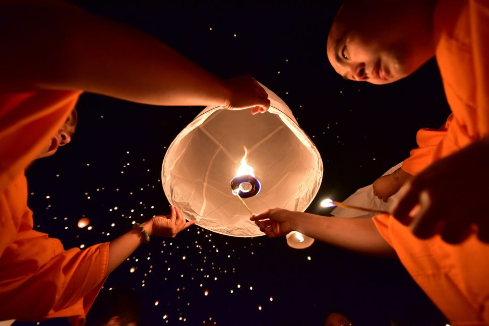 People launch Kongming lanterns during the Water-Sprinkling Festival in China's Xishuangbanna autonomous prefecture on A
