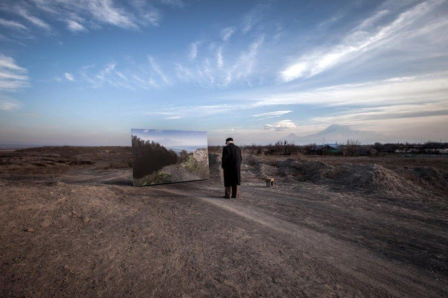Movses Haneshyan, 105, approaches a life-size landscape of his hometown, Musa Dagh. (Photo copyright: Diana Markosian)