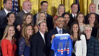 WASHINGTON, Oct. 28, 2015-- U.S. President Barack Obama poses for group photos with members of the U.S. Women's National Soccer Team during a ceremony to honor them and their victory in the 2015 FIFA Women's World Cup at the East Room of the White House in Washington D.C., Oct. 27, 2015.  (Xinhua/Yin Bogu via Getty Images)