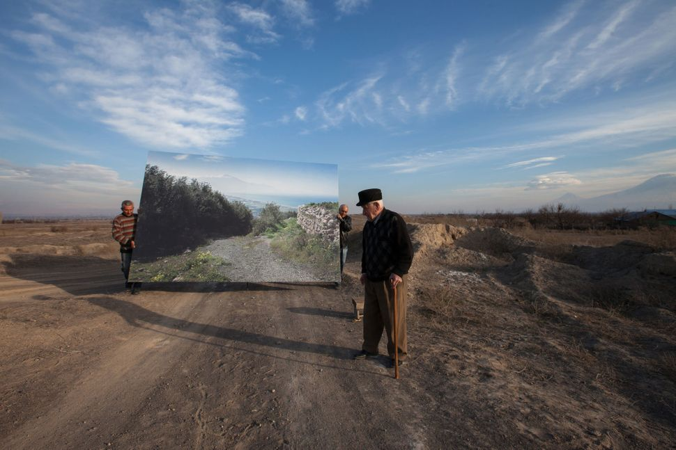 Movses Haneshyan, 105, with a life-size landscape of his hometown, Musa Dagh. (Photo copyright: Diana Markosian)