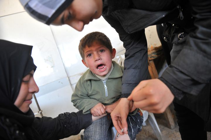 The latest affliction to hit weary residents of Aleppo is written on their faces. Some call it the 'Aleppo button', a welt caused by leishmaniasis, an illness that is sweeping Syria.