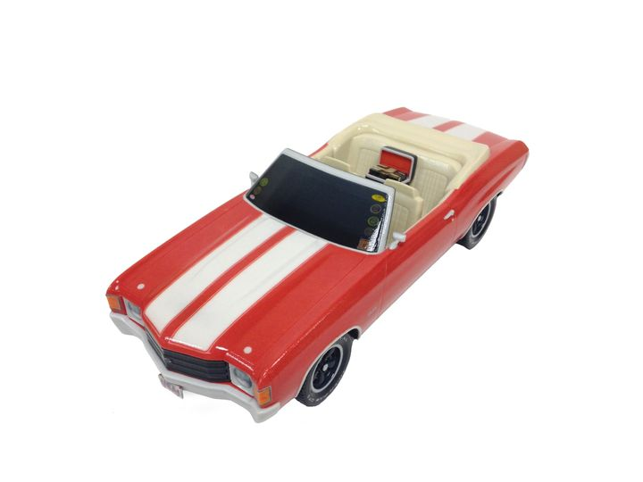 A Chevrolet Chevelle urn that Foreverence designed included box of 8-track tapes in the back seat, a personalized license plate and car club stickers.