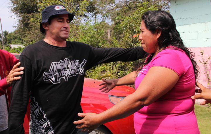 Jose Salvador Alvarenga greets Roselia Diaz, mother of dead castaway Ezequiel Cordoba, March 15, 2014.