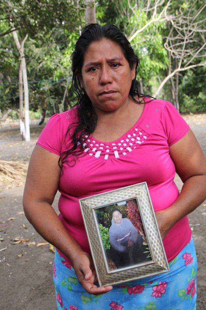 Roselia Diaz, mother of dead castaway Ezequiel Córdoba, shows her son's portrait.