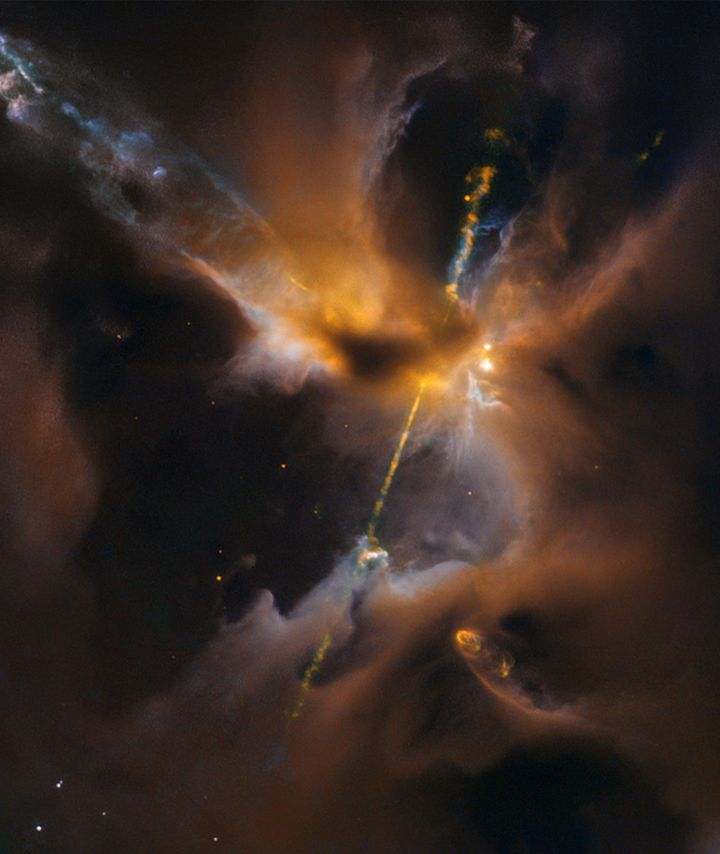 """This celestial """"lightsaber"""" spotted by the Hubble Space Telescope was formed by superheated matter ejected from the poles of"""