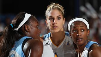 ROSEMONT, IL - JUNE 29: Elena Delle Donne #11 of the Chicago Sky confers with teammates Michelle Campbell #25 (L) and Swin Cash #8 (R) during a timeout in the game against the Los Angeles Sparks on June 29, 2013 at the Allstate Arena in Rosemont, Illinois. NOTE TO USER: User expressly acknowledges and agrees that, by downloading and/or using this photograph, user is consenting to the terms and conditions of the Getty Images License Agreement.  Mandatory Copyright Notice: Copyright 2013 NBAE (Photo by Gary Dineen/NBAE via Getty Images)