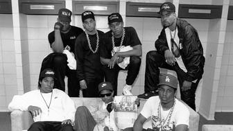 KANSAS CITY - JUNE 1989:  Rap group N.W.A. pose with rappers The D.O.C. and Laylaw from Above The Law (L-R standing: Laylaw, DJ Yella, Dr. Dre and The D.O.C. seated Ice Cube, Eazy-E and MC Ren)backstage at the Kemper Arena during their 'Straight Outta Compton' tour in June 1989 in Kansas City, Missouri.     (Photo by Raymond Boyd/Michael Ochs Archives/Getty Images)