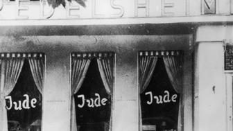 circa 1938:  'Jude' ('Jew') anti-semitic graffiti on shop windows, Berlin, Germany.  (Photo by Anthony Potter Collection/Getty Images)