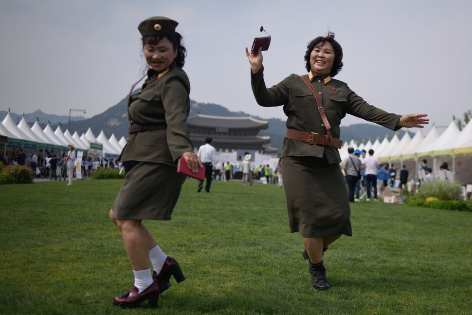 "North Korean defectors wearing the country's military uniforms dance at a ""<a href=""http://english.yonhapnews.co.kr/news/2015"