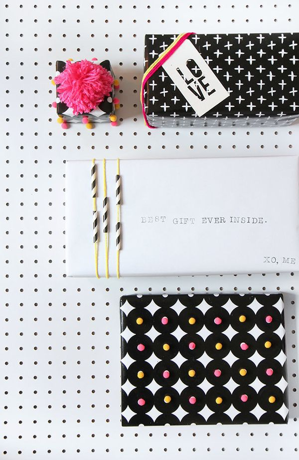 """Never have straws looked so chic. <a href=""""http://ispydiy.com/2014/12/16/holiday-diy-gift-wrapping/#more-6970"""" target=""""_blank"""