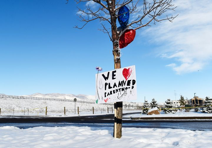 A sign supporting Planned Parenthood hangs near the entrance of the Planned Parenthood facility in Colorado Springs after a g