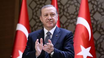 ANKARA, TURKEY - DECEMBER 14: President of Turkey Recep Tayyip Erdogan claps during the 2015 Turkish Academy of Sciences award ceremony at Presidential Complex in Ankara, Turkey on December 14, 2015. (Photo by Yasin Bulbul/Presidency/Anadolu Agency/Getty Images)