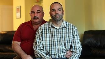DORCHESTER, MA - JANUARY 29: Matthew Barrett, right,  and his husband Ed Suplee. Matt is filing a lawsuit accusing Fontbonne Academy, a Catholic affiliated school in Milton, of discrimination for reversing its decision to hire him after finding out he is gay and has a husband. (Photo by Suzanne Kreiter/The Boston Globe via Getty Images)