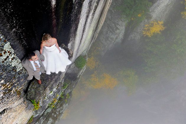 Am extreme wedding picture taken on the White Mountains of New Hampshire. See Ross Parry copy RPYEDGE: Meet the photographer who makes newlyweds feel sky-high after their nuptials à by snapping them 350ft in the air. Daredevil Jay Philbrick offers couples a truly unique wedding album by encouraging them to put their lives in each otherÃs hands and suspend themselves from a sheer clifftop. In these jawdropping images, bride and groom Christie Sulkoski and Kevin Coleman can be seen testing their new marriage to the limit as she holds on to her husbandÃs hand for dear life while dangling from a rocky ledge.