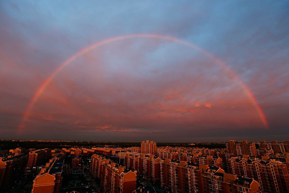 "A rainbow appears over Beijing on Aug. 3.&nbsp;Air pollution levels in and around the city&nbsp;<a href=""https://www.huffpost"