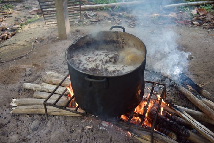 The ayahuasca plant brew is seen here being cooked over a wood fire