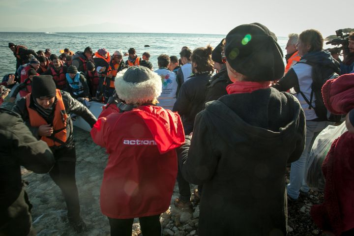 Susan Sarandon and other volunteers welcome refugees to Lesbos, Greece.