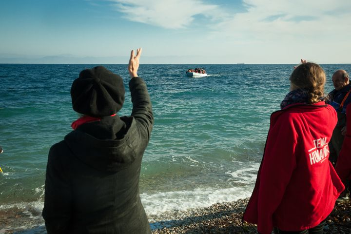 Susan Sarandon and other volunteers greet a boat of refugees in Lesbos, Greece.