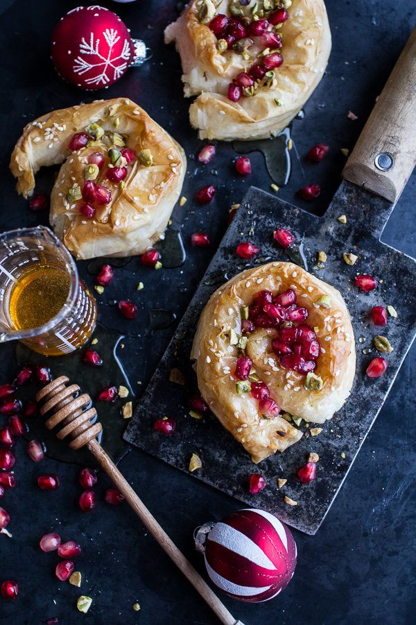"""<strong>Get the <a href=""""http://www.halfbakedharvest.com/goat-cheese-stuffed-phyllo-swirls-pomegranate-honey-pistachios/"""">Goa"""