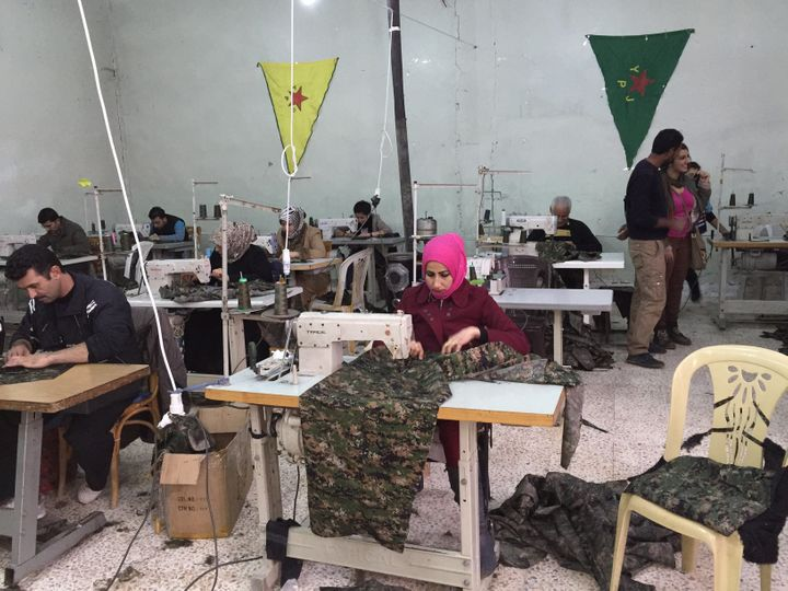 A Rojava sewing cooperative in Derik, Rojava, Syria, in December 2014. Workers are sowing uniforms for the Syrian Kurds' mili