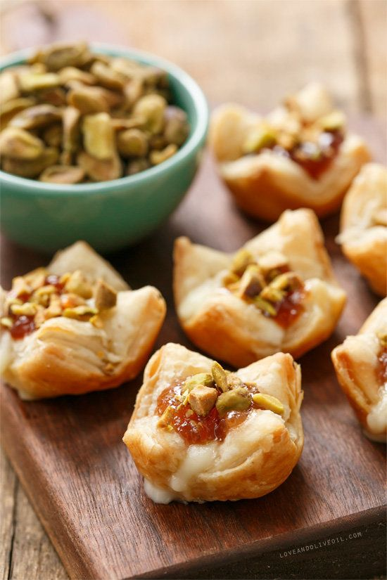 """<strong>Get the <a href=""""http://www.loveandoliveoil.com/2013/12/baked-brie-puffs-with-fruit-preserves-and-pistachios.html"""">Ba"""