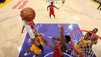 LOS ANGELES, CA - DECEMBER 17: Kobe Bryant #24 of the Los Angeles Lakers goes for the dunk during the game against the Houston Rockets on December 17, 2015 at STAPLES Center in Los Angeles, California. NOTE TO USER: User expressly acknowledges and agrees that, by downloading and/or using this Photograph, user is consenting to the terms and conditions of the Getty Images License Agreement. Mandatory Copyright Notice: Copyright 2015 NBAE (Photo by Andrew D. Bernstein/NBAE via Getty Images)