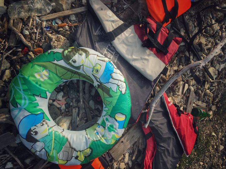 Children's pool toys, along with life jackets, inner tubes and rubber boats, make up the debris littering the Greek isla