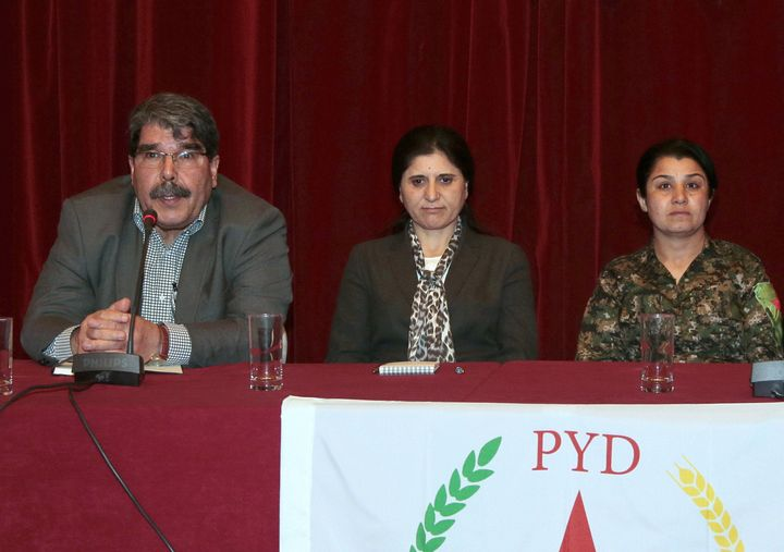 PYD co-presidents Saleh Muslim Mohammed (L) and Asya Abdullah with Syrian Kurdish fighter Nasrin Abdullah (R) at a press conf