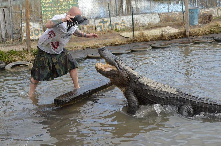Jason McDonald with Elvis the alligator.