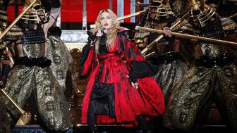 US singer Madonna performs during a concert at the AccorHotels Arena in Paris on December 9, 2015.  / AFP / FRANCOIS GUILLOT        (Photo credit should read FRANCOIS GUILLOT/AFP/Getty Images)