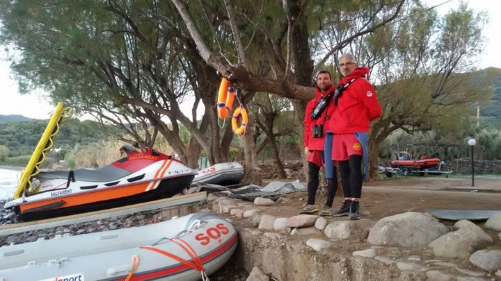 Enrique Álvarez poses on shore withanother volunteer fromProactiva Open Arms in Lesbos, Greece.