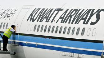 (FILES) In a file picture dated November 1, 2006, a ground crewmember takes a peek inside the cabin of a Kuwait Airways Airbus A340 at the Kuala Lumpur International Airport in Sepang. State-owned Kuwait Airways Corp. (KAC) is expected to be privatised within 10 months, its chairman Hamad al-Falah said on June 12, 2008. AFP PHOTO/TENGKU BAHAR (Photo credit should read TENGKU BAHAR/AFP/Getty Images)