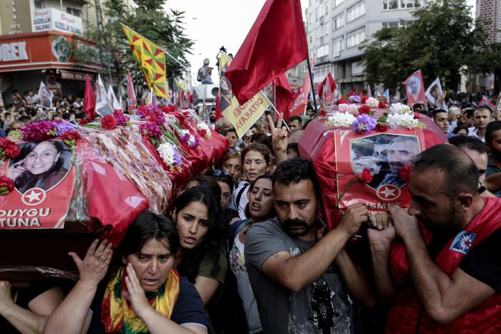 Mourners in Istanbul, Turkey, carry the coffins of two victims of the attack on the Turkish town of Suruc, on July 22, 2