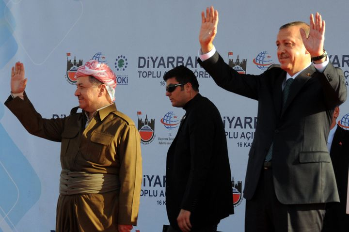 Turkish Prime Minister Recep Tayyip Erdogan (R) and Iraqi Kurdish leader Massud Barzani (L) wave on November 16, 2013 in the