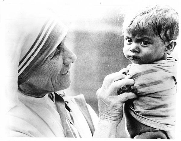 Mother Teresa of Calcutta, shown with an Indian child in 1977, worked to help sick and homeless victims in the cyclone-ravage