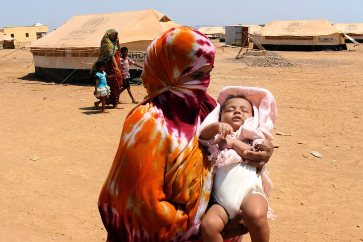OBOCK, DJIBOUTI - MAY 18: A Yemeni woman with his baby, fled the air strikes that have devastated their country, takes shelte