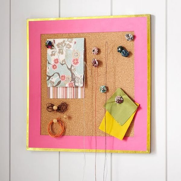 "Corkboard, $24 at <a href=""http://www.pbteen.com/products/paper-border-corkboard-gold-trim/?pkey=cbulletin-boards-dorm-study&"