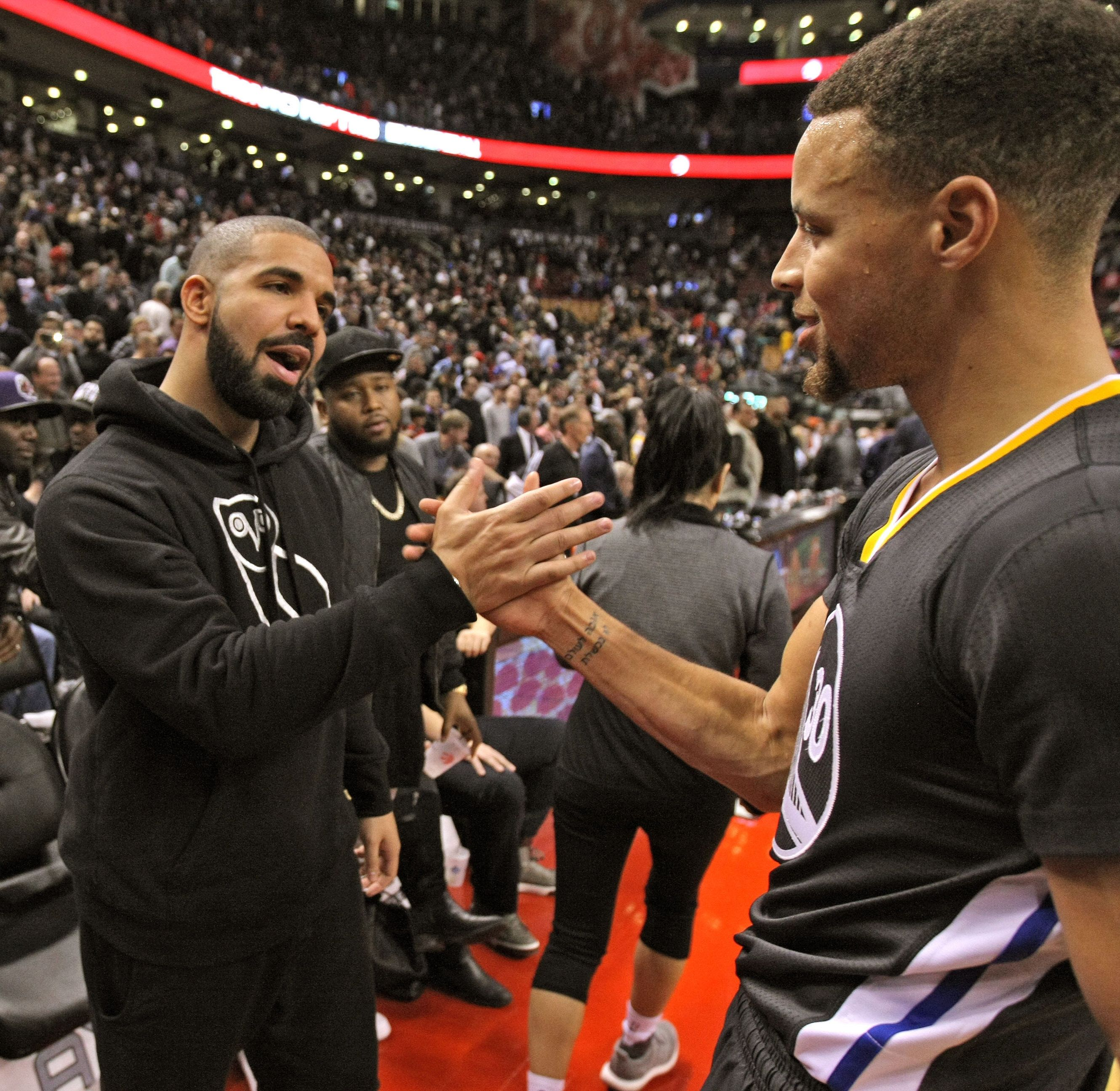 TORONTO, ON - DECEMBER 5:  Drake and Stephen Curry #30 of the Golden State Warriors after the game against the Toronto Raptors on December 5, 2015 at Air Canada Centre in Toronto, Ontario, Canada. NOTE TO USER: User expressly acknowledges and agrees that, by downloading and or using this photograph, User is consenting to the terms and conditions of the Getty Images License Agreement. Mandatory Copyright Notice: Copyright 2015 NBAE (Photo by Dave Sandford/NBAE via Getty Images)
