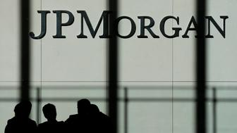 FILE - In this Monday, Oct. 21, 2013., file photo, the JPMorgan Chase & Co. logo is displayed at their headquarters in New York. JPMorgan Chase & Co. said Friday, Nov. 15, 2013, it has reached a $4.5 billion settlement with investors over mortgage-backed securities. (AP Photo/Seth Wenig, File)