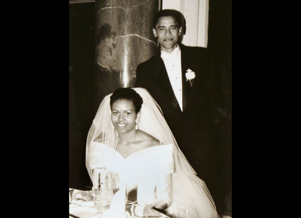 This black-and-white photo released by Obama for America shows President Barack Obama and his bride Michelle Robinson on thei