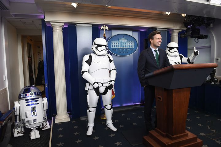 White House press secretary Josh Earnest appears in the White House Briefing Room with R2D2 and two Stormtroopers ahead of a
