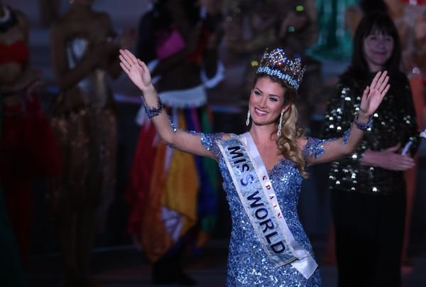Mireia Lalaguna Rozo of Spain waves after winning the new title at the Miss World Grand Final in Sanya, in southern China's H