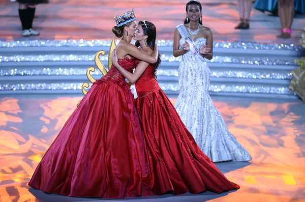 Former Miss World, Rolene Strauss (L), and Miss Russia, Sofia Nikitchuk, hug during the Miss World Grand Final in Sanya in so