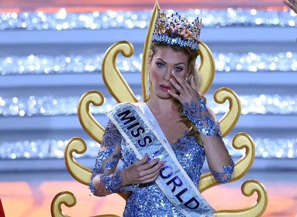 Mireia Lalaguna Rozo of Spain reacts after winning the new title at the Miss World at the Grand Final in Sanya, in southern C